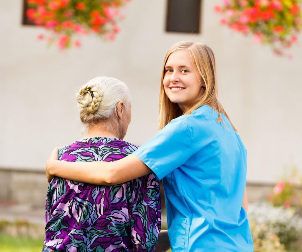 nurse caring for senior woman