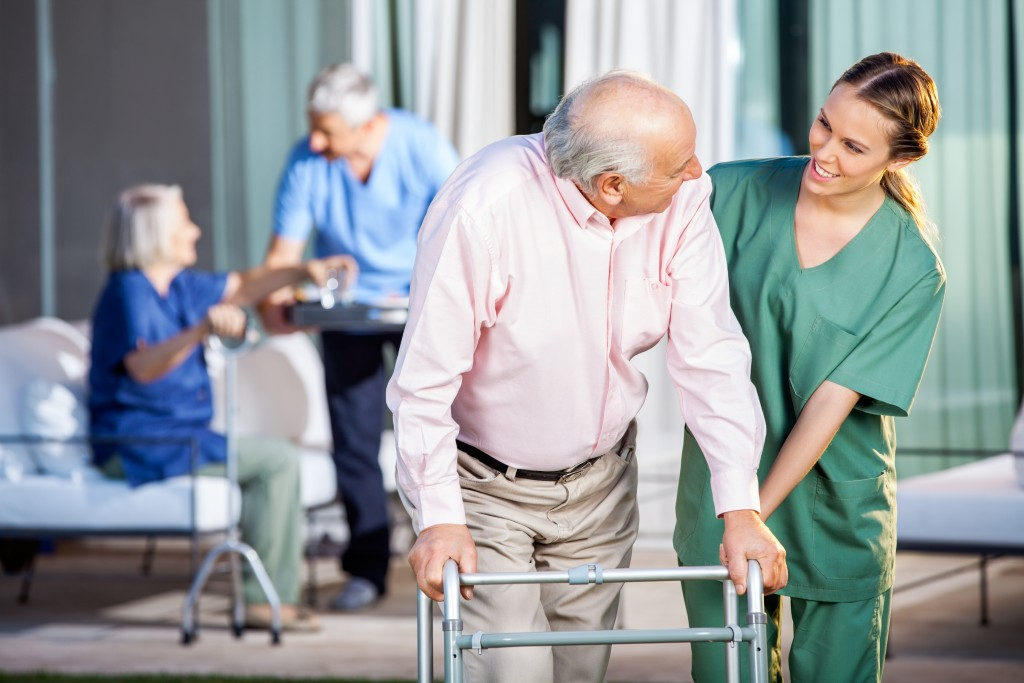 nurse caring for senior man