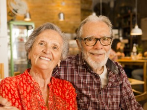 happy senior couple in a cafe